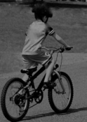 boy_bike_street_375px